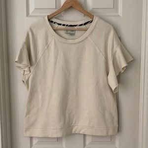 Anthropologie cream short sleeve ruffle  MED